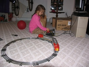 Sam with her great-grandfather's trains
