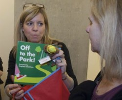 Alex with a copy of 'Off to the Park!' at the Bookstart Star launch
