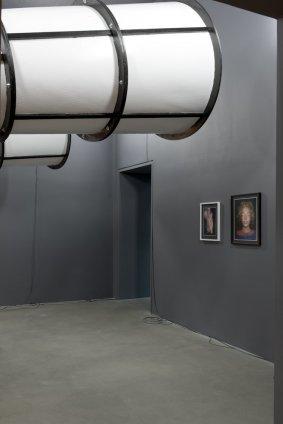 Thomas Zipp  POLYMORPHOUS ORATORY, 2012  Mixed Media  Painting (black) with serrated saw blade: 180 x 150 cm, 70 7/8 x 59 1/8 ins Table: 97 x 131 x 51 cm, 38 2/8 x 51 6/8 x 20 1/8 ins Conical system: 379.5 x 666 x 444 cm, 149 4/8 x 262 2/8 x 174 7/8 ins 10 Neon Lights: 62 x 42 cm, 24 4/8 x 16 4/8 ins