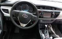 2014 Toyota Corolla - steering wheel and instrument panel.JPG