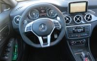 2014 Mercedes-Benz CLA - steering wheel and instrument panel.JPG