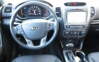 2014 Kia Sorento - steering wheel and instrument panel.JPG