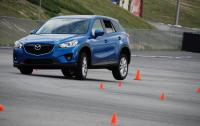 2012 Mazda CX-5 - front 3/4 motion on track.JPG