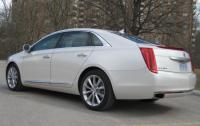 2013 Cadillac XTS - rear 3/4 view low.JPG