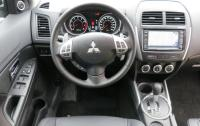 2013 Mitsubishi RVR - steering wheel and instrument panel.JPG