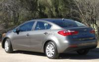 2014 Kia Forte - rear 3/4 view.jpg