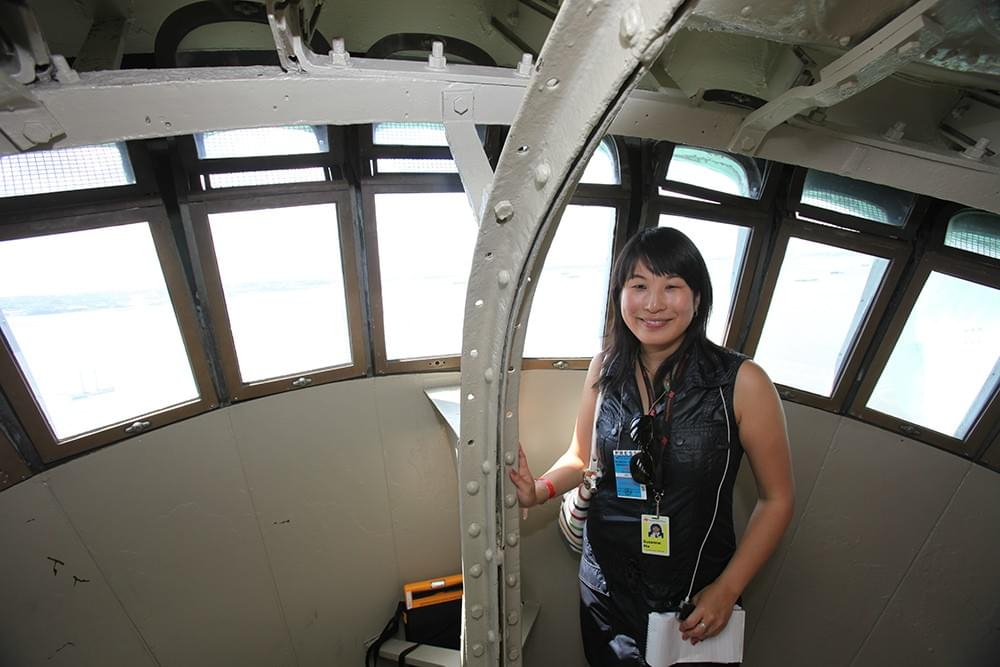 Journalist Suzanne Ma reporting for the Associated Press from the Statue of Liberty's crown in New York in 2009.