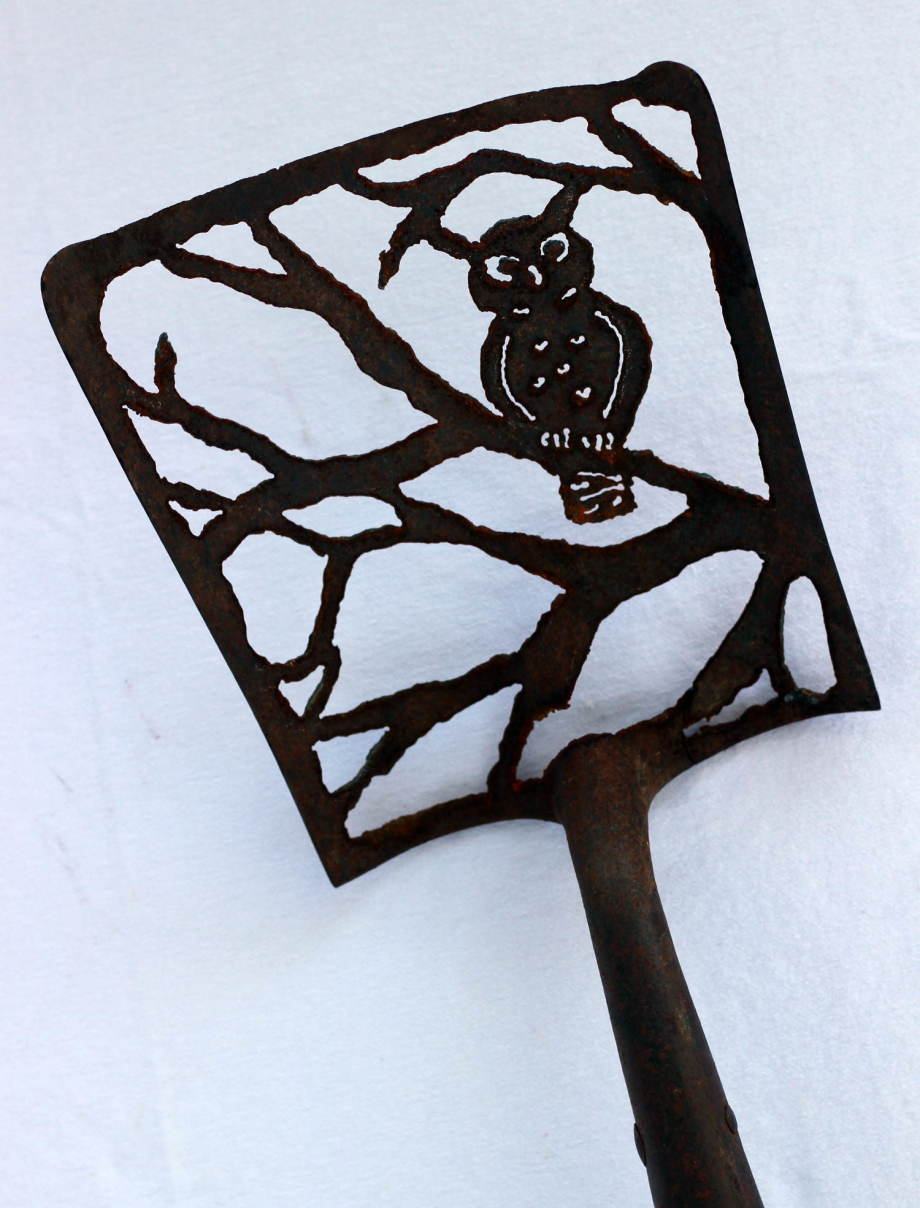 Horned owl in tree shovel