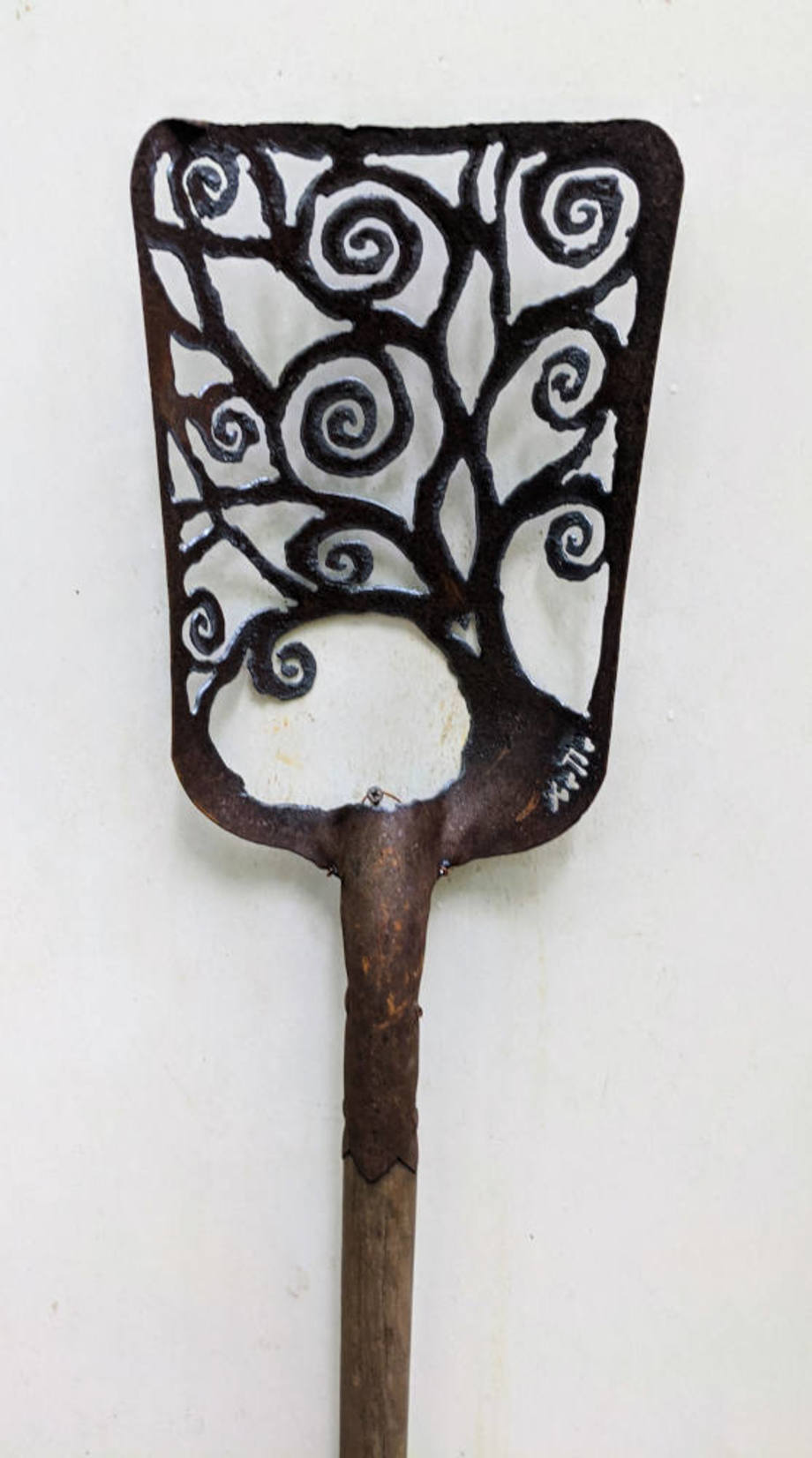 Leaning Spiral Tree shovel