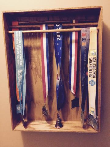 The completed rack, hung and displaying medals.