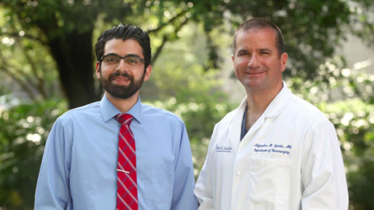 MUSC research team lead Dr. Spiotta (on right) worked with Dr. Alawieh to study endovascular thrombectomy procedure times both at MUSC and nationally.