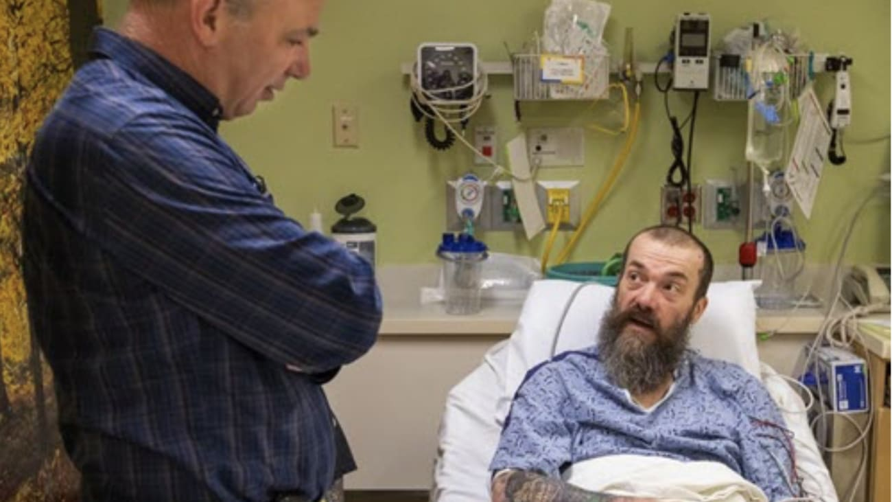 Jeffrey G. Ojemann, M.D., Division Chief of Neurosurgery at UW Medicine, left, talks with former tattoo artist Gary Williams before Williams underwent microsurgery to remove the part of his brain responsible for debilitating seizures. Williams agreed to donate the small bit of healthy tissue that had to be removed during the operation for scientific analysis.