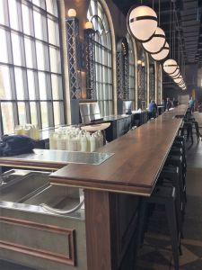 100-foot, commercial bar top finish, walnut bar top, wide plank wood, bronze banding, decorative edge profile, marine finish