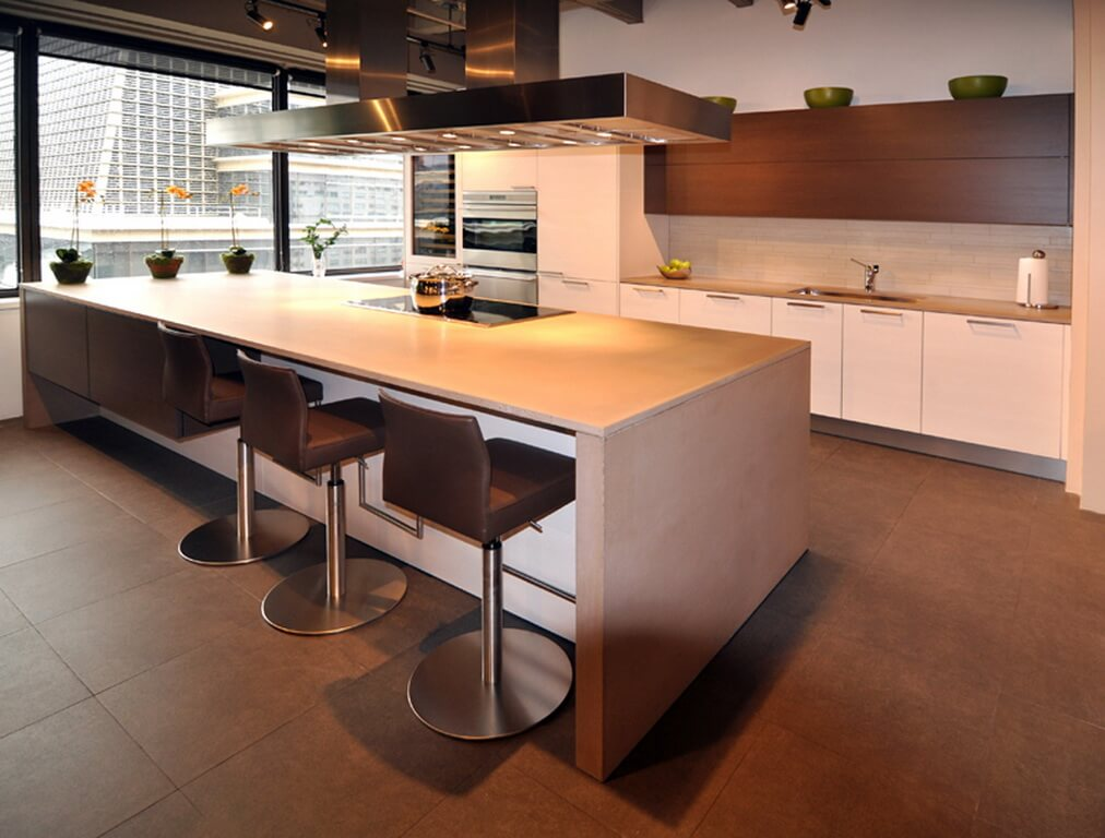 Sand Colored Waterfall Style Concrete Island Countertop