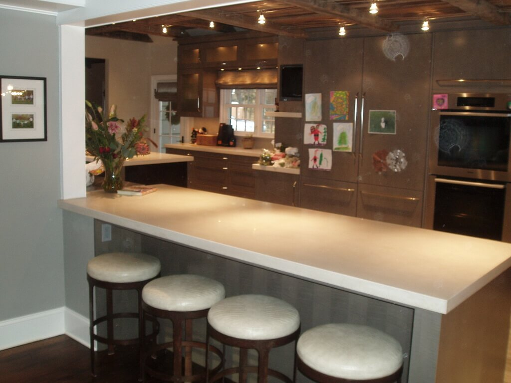 Transitional Kitchen with Concrete Peninsula Countertop