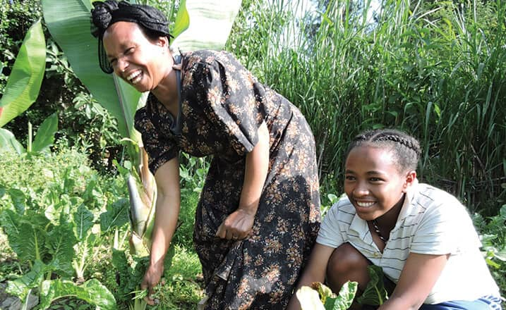 Zenebech works with her daughter in the garden outside their home in Addis Ababa