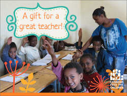 Charity gifts for teachers come with a free card showing children in a classroom in Africa