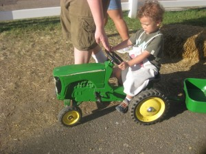 This was an unyielding tractor for Lincoln to pull (it also had a trailer attached to it).  Since Lincoln is learning to ride on the Strider he is not used to pedals since he is learning balance on a 2 wheeler.  We ended up having to cut the tractor ride short at the Little Farm Hands Exhibit.