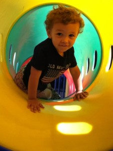 Playing in the tunnels on the playground equipment at school.