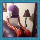 Purple hat with red braided pigtails