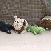 Amigurumi seal, lion, alligator, and hippo
