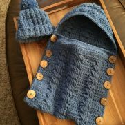 Crocheted baby bunting with matching hat