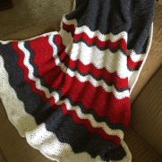 Crocheted OSU baby ripple blanket