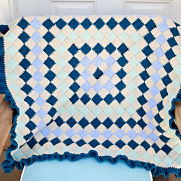 Peacock blue, teal, light blue, and beige entrelac baby blanket