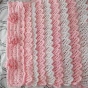 pink and white frilled crochet blanket