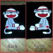 crocheted reversable Sock Monkey Blanket
