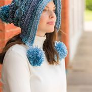 Lacy Pompom Snow Hat featured in Crochet! magazine.