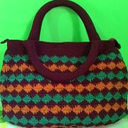 Spike stitch handbag