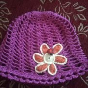 Summer hat with flower and ladybug
