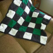 Crocheted Solid Granny Square lap throw