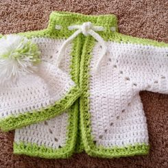 Three little sweaters with beanies