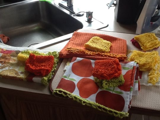 Crocheted edgings on t towels and cotton face cloths