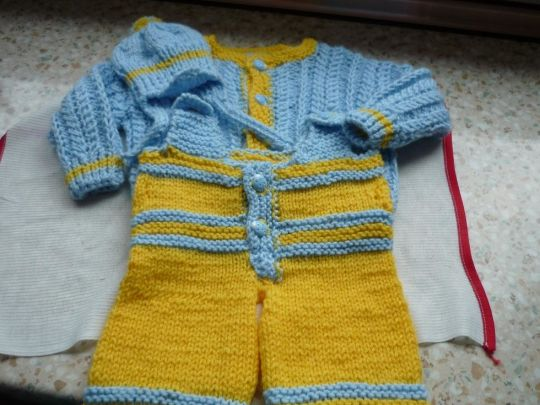 yellow and blue overalls with sweater