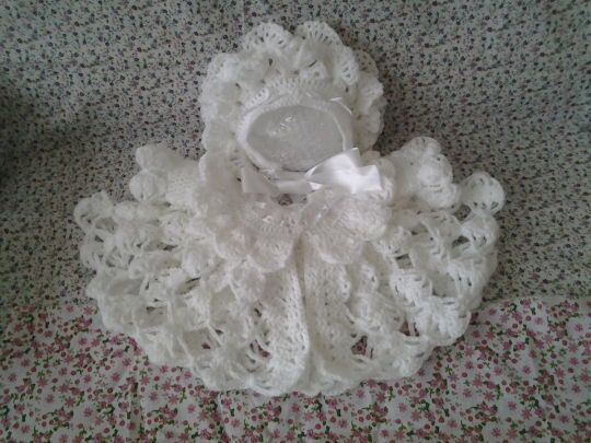 Beautiful frilled coat and petal design hat
