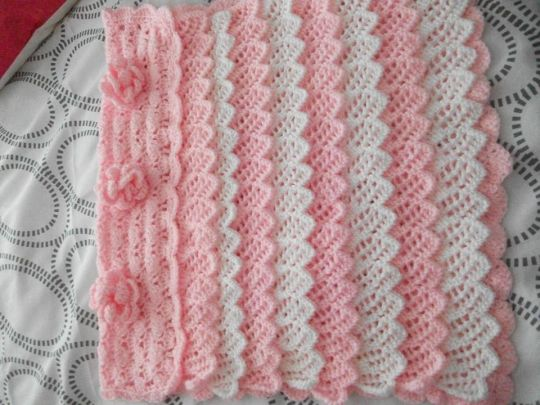 blanket with flowers and frills