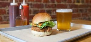 $17 Chopped Pig & Beer at Old Faithful Bar & BBQ