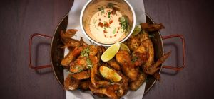 $15 Crispy Creole Chicken Wings at The Newport Hotel