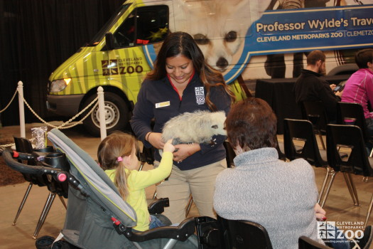 Adriana and Opossum with kid touching- 2014 RV Show