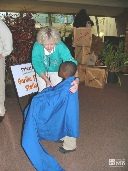 2007 Primate Awareness Day - Volunteer Joan Rog helps a child try on a gorilla sized shirt