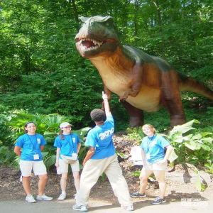Zoo Crew Members and Dinosaur