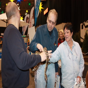 Jim Nemet with Boa and adults touching- 2014 RV Show