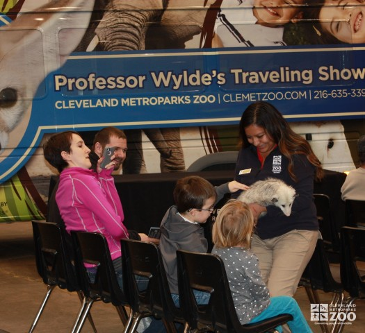 Adriana and Opossum with kids and mom takes pictures- 2014 RV Show