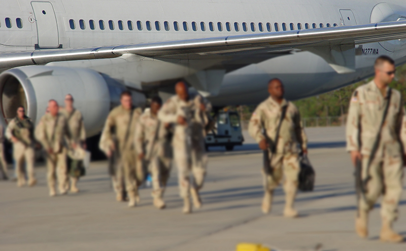 soldiers leaving plane