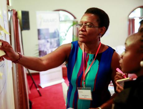 Sarah Mubiru, managing director of Aroma Honey Toffee Ltd, brainstorming at a Gender in Agribusiness Investments for Africa workshop © AWARD