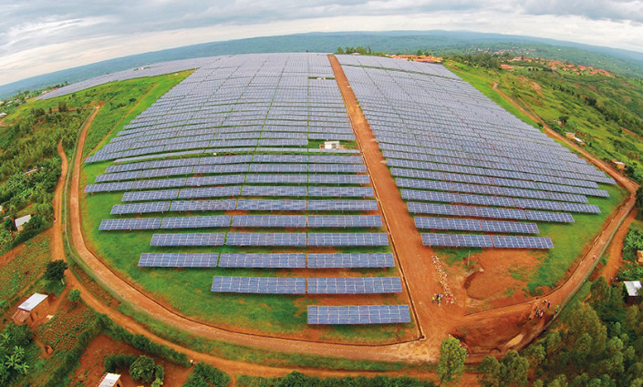 A solar field in Rwanda helps the long-term sustainability of the village,  is good for the environment and generates local employment  and education © S.Halai (USAID/POWER AFRICA)