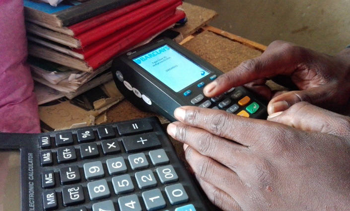 Milambo Maambo's agro-shop use the Zoona mobile transfer platform to supply inputs to smallholder farmers © Friday Phiri